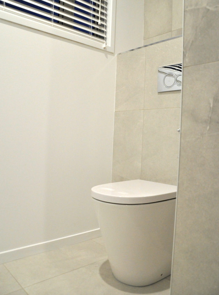 Toilet with in-wall cistern